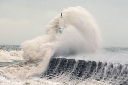 (Aaron Chown/PA via AP). Waves crash over the stone jetty wall in Aberystwyth in west Wales as Storm Eleanor lashed Britain with violent storm-force winds of up to 100mph, leaving thousands of homes without power and hitting transport links Wednesday J...