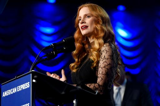 """(Photo by Chris Pizzello/Invision/AP). Jessica Chastain accepts the chairman's award for """"Molly's Game"""" at the 29th annual Palm Springs International Film Festival on Tuesday, Jan. 2, 2018, in Palm Springs, Calif."""