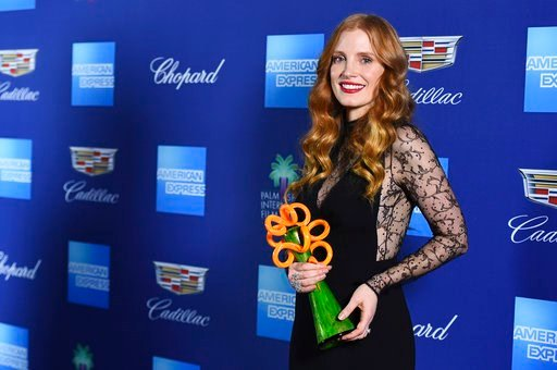 (Photo by Jordan Strauss/Invision/AP). Jessica Chastain poses in the press room with the chairman's award at the 29th annual Palm Springs International Film Festival on Tuesday, Jan. 2, 2018, in Palm Springs, Calif.