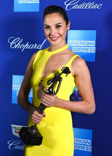 """(Photo by Jordan Strauss/Invision/AP). Gal Gadot poses in the press room with the rising star award-actress for """"Wonder Woman"""" at the 29th annual Palm Springs International Film Festival on Tuesday, Jan. 2, 2018, in Palm Springs, Calif."""