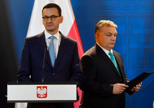 (Tibor Illyes/MTI via AP). Staying on an official visit in Hungary new Polish Prime Minister Mateusz Morawiecki, left, and his Hungarian counterpart Viktor Orban arrive for their joint news conference following their talks in the Parliament building in...