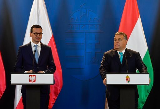 (Tibor Illyes/MTI via AP). Staying on an official visit in Hungary new Polish Prime Minister Mateusz Morawiecki, left, listens to his Hungarian counterpart Viktor Orban during their joint news conference following their talks in the parliament building...