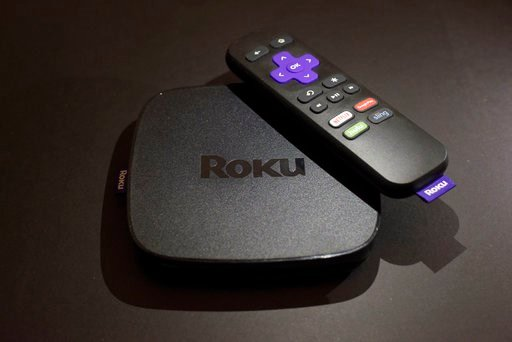 (AP Photo/Patrick Sison, File). FILE - This Nov. 16, 2016 file photo shows the Roku Premiere streaming TV device in New York.  Roku plans to add a voice-controlled digital assistant to expanding lineup of online video players in an attempt to catch up ...