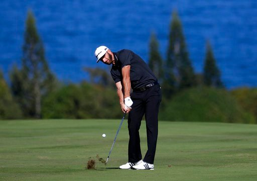 (AP Photo/Matt York, File). FILE - In this Jan. 7, 2017, file photo, Dustin Johnson hits from the fourth fairway during the third round of the Tournament of Champions golf event at Kapalua Plantation Course in Kapalua, Hawaii. Johnson is No. 1 in the w...