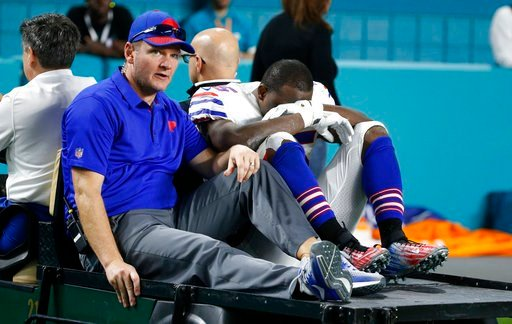 (AP Photo/Wilfredo Lee). Buffalo Bills running back LeSean McCoy (25) is driven off the field after he was injured on a play, during the second half of an NFL football game against the Miami Dolphins, Sunday, Dec. 31, 2017, in Miami Gardens, Fla.