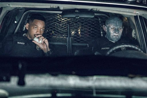 """(Matt Kennedy/Netflix via AP, File). FILE - This undated image released by Netflix shows Will Smith, left, and Joel Edgerton in a scene from, """"Bright."""" Despite scathing reviews from critics, Netflix has greenlit a sequel to """"Bright,"""" with star Smith an..."""