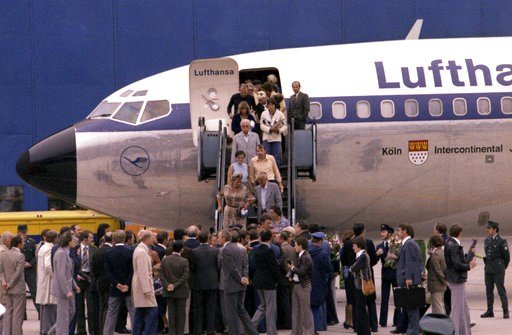 (AP Photo/Dieter Endlicher). FILE - In this Oct. 18, 1977 file photo the first freed hostages step down the gangway after landing at Frankfurt am Main's airport, in West Germany. Ulrich Wegener, the commander of the German paramilitary unit that ended ...