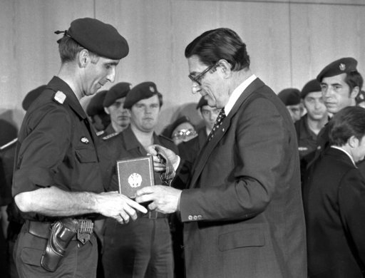 (AP Photo). FILE - In this Oct. 20, 1977 file photo the Commander of West German anti terror squad, the GSG 9, of the border police, Ulrich Wegner, left, is awarded with the Federal Cross of Merit at the Chancellory in Bonn, West Germany, October 20, 1...