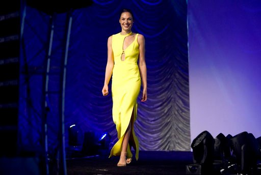 "(Photo by Chris Pizzello/Invision/AP). Gal Gadot appears on stage to accept the rising star award-actress for ""Wonder Woman"" at the 29th annual Palm Springs International Film Festival on Tuesday, Jan. 2, 2018, in Palm Springs, Calif."
