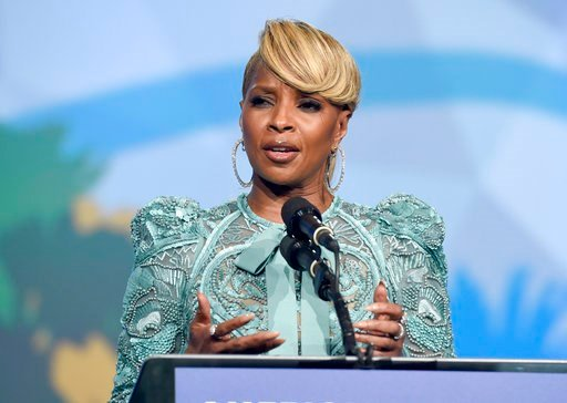 "(Photo by Chris Pizzello/Invision/AP). Mary J. Blige accepts the breakthrough performance award for ""Mudbound"" at the 29th annual Palm Springs International Film Festival on Tuesday, Jan. 2, 2018, in Palm Springs, Calif."