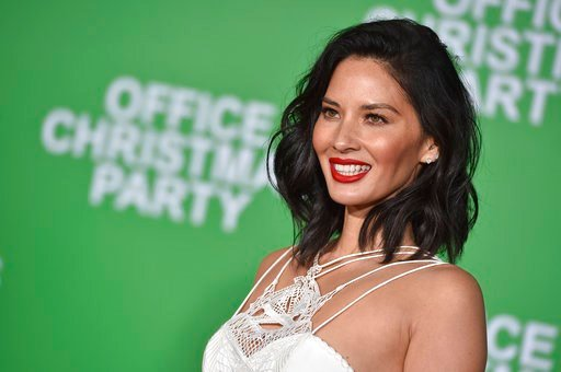"""(Photo by Jordan Strauss/Invision/AP, File). FILE - In this Dec. 7, 2016, file photo, Olivia Munn arrives at the premiere of """"Office Christmas Party"""" at the Village Theatre Westwood in Los Angeles. Organizers said Wednesday, Jan. 3 2018, that Munn will..."""