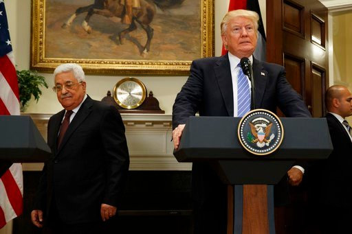 (AP Photo/Evan Vucci, File). FILE - In this May 3, 2017 file photo, President Donald Trump and Palestinian Authority President Mahmoud Abbas arrive in the Roosevelt Room of the White House in Washington. With a Twitter post on Tuesday, Jan. 2, 2018, th...