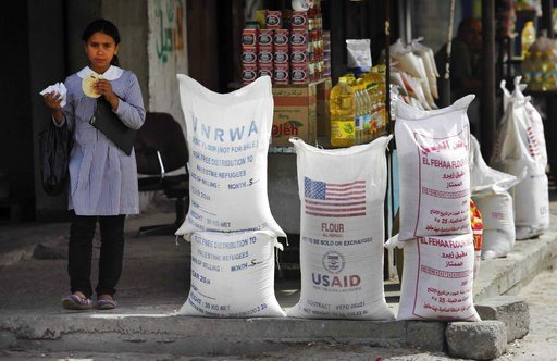(AP Photo/Lefteris Pitarakis, File). File - In this June 6, 2010 file photo, sacks of flour, some part of humanitarian aid by UNRWA and USAID, but now offered for sale by a vendor, sit outside a food store in Gaza City. With a Twitter post on Tuesday, ...