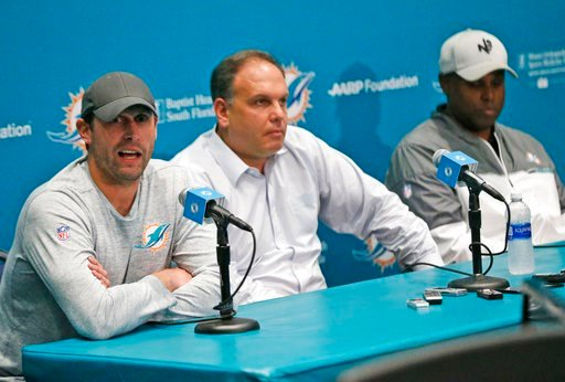 (AP Photo/Wilfredo Lee). Miami Dolphins head coach Adam Gase, left, answers a question during a news conference with Mike Tannenbaum, center, executive vice president of football operations, and Chris Grier, general manager, at the teams NFL football t...