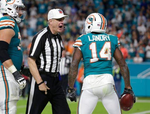 (AP Photo/Lynne Sladky). NFL referee Jeff Triplette ejects Miami Dolphins wide receiver Jarvis Landry (14) from the game for unsportsmanlike conduct, during the second half of an NFL football game against the Buffalo Bills, Sunday, Dec. 31, 2017, in Mi...