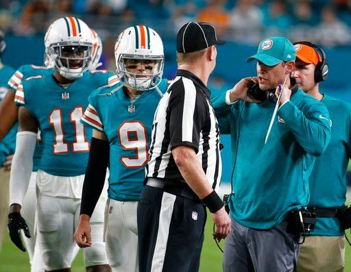 (AP Photo/Wilfredo Lee). Miami Dolphins head coach Adam Gase talks to side judge Terry Brown after several players were ejected from the game, during the second half of an NFL football game against the Buffalo Bills, Sunday, Dec. 31, 2017, in Miami Gar...