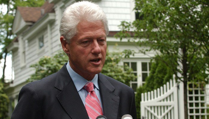 Former President Bill Clinton speaks with reporters outside his home in Chappaqua,NY,in this July 28, 2005. file photo. A fire was reported at the home on Wednesday.  (AP Photo/Jennifer Szymaszek)