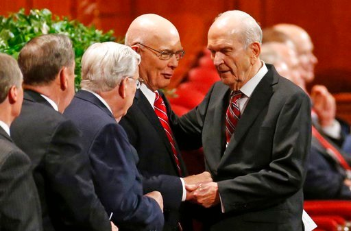 (AP Photo/Rick Bowmer, File). FILE - In this Sept. 30, 2017, file photo, Russell M. Nelson, right, president of the Quorum of the Twelve Apostles, right, greets members of the Quorum, before the start of the morning session of the two-day Mormon church...