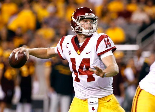 (AP Photo/Ralph Freso, File). FILE - In this Saturday, Oct. 28, 2017 file photo, Southern California quarterback Sam Darnold throws a pass during the first half of an NCAA college football game against Arizona State in Tempe, Ariz. Southern California ...