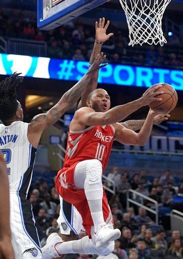 (AP Photo/Phelan M. Ebenhack). Houston Rockets guard Eric Gordon (10) goes up for a shot in front of Orlando Magic guard Elfrid Payton (2) during the first half of an NBA basketball game Wednesday, Jan. 3, 2018, in Orlando, Fla.