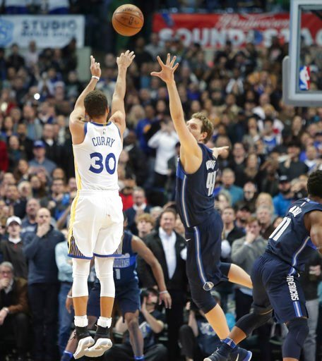 (AP Photo/LM Otero). Golden State Warriors guard Stephen Curry (30) takes the last shot of the game against Dallas Mavericks forward Dirk Nowitzki (41) of Germany during the second half of an NBA basketball game in Dallas, Wednesday, Jan. 3, 2018.