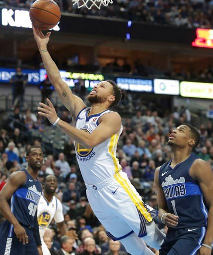 (AP Photo/LM Otero). Golden State Warriors guard Stephen Curry (30) drives past Dallas Mavericks guard Dennis Smith Jr. (1) during the first half of an NBA basketball game in Dallas, Wednesday, Jan. 3, 2018.