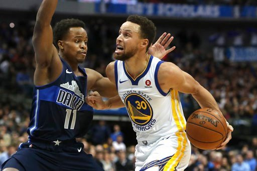 (AP Photo/LM Otero). Golden State Warriors guard Stephen Curry (30) drives against Dallas Mavericks guard Yogi Ferrell (11) during the first half of an NBA basketball game in Dallas, Wednesday, Jan. 3, 2018.