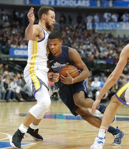 (AP Photo/LM Otero). Golden State Warriors guard Stephen Curry (30) defends Dallas Mavericks guard Dennis Smith Jr. (1) during the second half of an NBA basketball game in Dallas, Wednesday, Jan. 3, 2018.