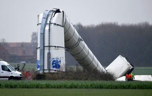 (Holger Hollemann/dpa via AP). A wind power facility lies on a field after it collapsed during storm 'Burglind' in Volksdorf near Hannover, Germany, Wednesday, Jan. 3 2018. After parts of the rotor had broken, the tower of the roughly 70 meter tall win...