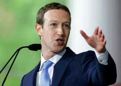 """(AP Photo/Steven Senne, File). FILE - In this May 25, 2017, file photo, Facebook CEO Mark Zuckerberg delivers the commencement address at Harvard University in Cambridge, Mass. Zuckerberg says his """"personal challenge"""" for 2018 is to fix Facebook. Zucke..."""