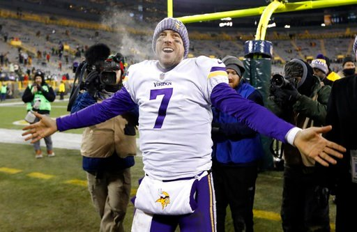 (AP Photo/Mike Roemer, File). FILE - In this Saturday, Dec. 23, 2017, file photo, Minnesota Vikings' Case Keenum celebrates after an NFL football game against the Green Bay Packers in Green Bay, Wis. The Vikings are back in the playoffs after a year's ...