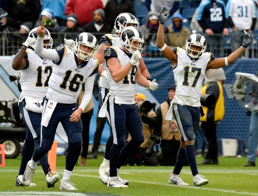 (AP Photo/Mark Zaleski, File). FILE - In this Dec. 24, 2017, file photo, Los Angeles Rams quarterback Jared Goff (16) and celebrates with wide receiver Cooper Kupp (18) after Kupp scored a touchdown against the Tennessee Titans in the second half of an...