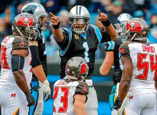 (AP Photo/Bob Leverone, File). FILE - In this Sunday, Dec. 24, 2017, file photo, Carolina Panthers' Cam Newton (1) signals his first down in the middle of the Tampa Bay Buccaneers defense during the first half of an NFL football game in Charlotte, N.C....