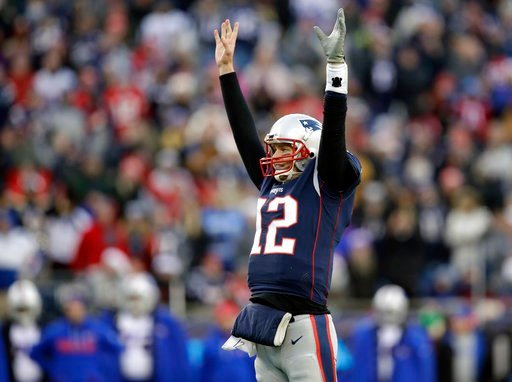 (AP Photo/Charles Krupa, File). FILE - In this Sunday, Dec. 24, 2017, file photo, New England Patriots quarterback Tom Brady celebrates a touchdown by running back Dion Lewis during the second half of an NFL football game against the Buffalo Bills,, in...