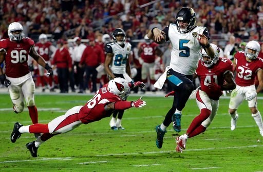 (AP Photo/Rick Scuteri, File). FILE - In this Nov. 26, 2017, file photo, Jacksonville Jaguars quarterback Blake Bortles (5) runs in a touchdown past Arizona Cardinals safety Budda Baker (36) and strong safety Antoine Bethea (41) during the second half ...