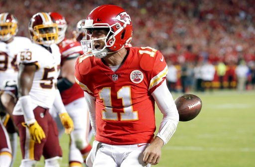 (AP Photo/Charlie Riedel, File). FILE - In this Oct. 2, 2017, file photo, Kansas City Chiefs quarterback Alex Smith (11) celebrates his touchdown during the second half of an NFL football game against the Washington Redskins in Kansas City, Mo. The Jag...