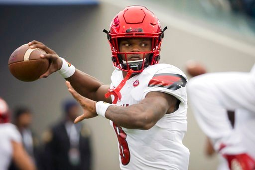 (AP Photo/Stephen B. Morton). Louisville Cardinals quarterback Lamar Jackson (8) warms up before the start of the TaxSlayer Bowl NCAA college football game against the Mississippi State Bulldogs, Saturday, Dec. 30, 2017, in Jacksonville, Fla.