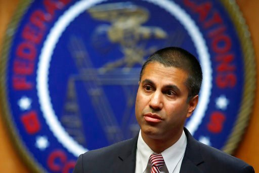 (FCC) Chairman Ajit Pai arrives for an FCC meeting where they will vote on net neutrality in Washington.  Published reports say Pai is skipping the CES gadget show because of death threats. Pai has scrapped popular net-neutrality rules that had barred ...