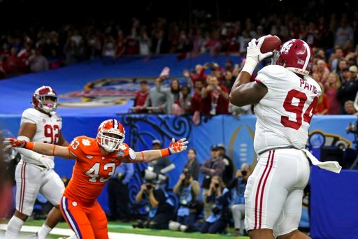 (AP Photo/Rusty Costanza). Alabama defensive lineman Da'Ron Payne (94), who was used on an offensive play, pulls in a touchdown reception as Clemson linebacker Chad Smith (43) reacts in the second half of the Sugar Bowl semi-final playoff game for the ...