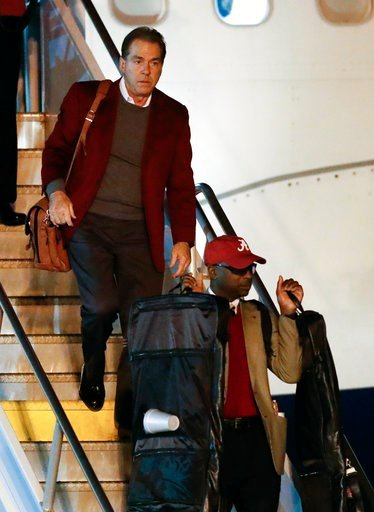 (AP Photo/John Bazemore). Alabama head coach Nick Saban, top, arrives with his team at Hartsfield-Jackson Atlanta International Airport in Atlanta, Friday, Jan. 5, 2018, for Monday night's NCAA college football championship game against Georgia.