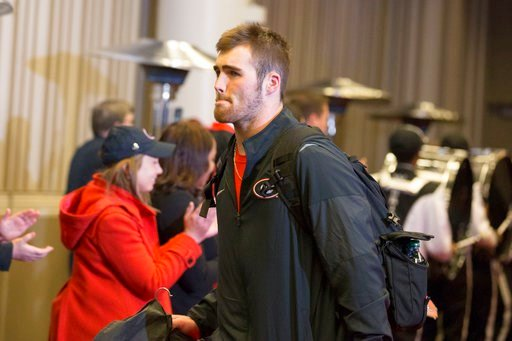 (Alyssa Pointer/Atlanta Journal-Constitution via AP). Georgia quarterback Jake Fromm arrives with the team at a hotel in Atlanta on Friday, Jan. 5, 2018. Georgia plays Alabama in the College Football Playoff title game Monday in Atlanta.