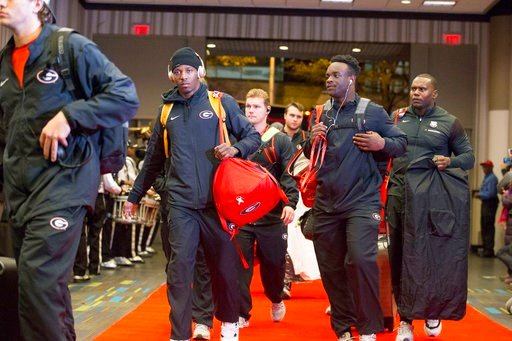 (Alyssa Pointer/Atlanta Journal-Constitution via AP). Georgia football team members arrive at a hotel Friday, Jan. 5, 2018, in Atlanta. Georgia plays Alabama in the College Football Playoff title game Monday in Atlanta.