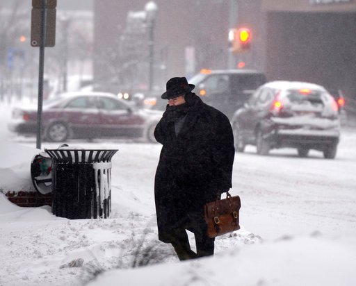 (Michael Greenlar/The Syracuse Newspapers via AP). A man crosses E. Washington St. in downtown Syracuse, N.Y. Friday, Jan. 5, 2018. Frigid temperatures, some that felt as cold as minus 30 degrees, moved across the East Coast on Friday as the region dug...