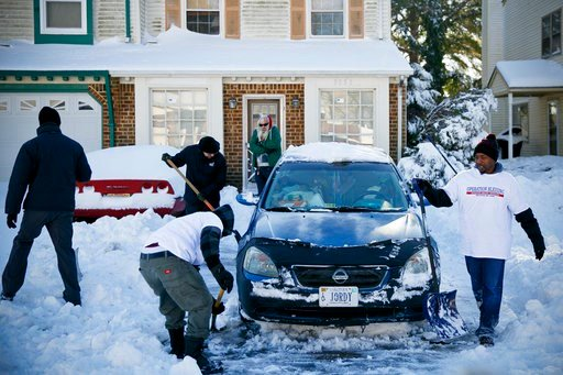 (Kristen Zeis/The Virginian-Pilot via AP). Victor Macros, fromleft, Fallah Willie, Alan Motes and Rodjane Bailey, all volunteers with Operation Blessing, work to shovel the driveway of resident, Jordan Gold, center, in Virginia Beach, Va., Friday, Jan....