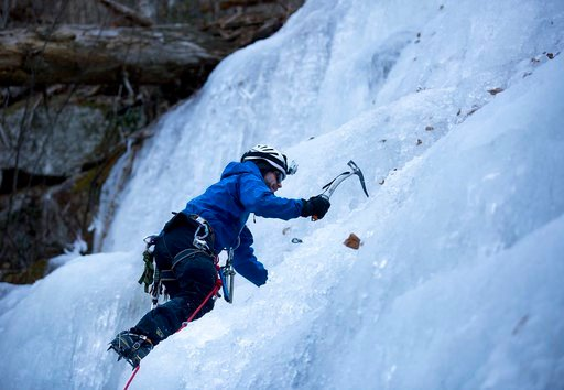 (Erica Yoon/The Roanoke Times via AP). Pat Metheny, 35, of Botetourt County, climbs his way up Crabtree Falls in Nelson County as his friend Greg Martin, 45, of Roanoke County, stands below on Friday afternoon, Jan. 5, 2017 in Nelson County, Va.. Methe...