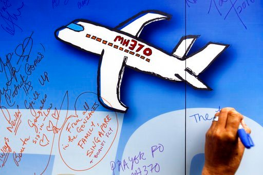 (AP Photo/Joshua Paul, File). FILE - In this March 6, 2016, file photo, well wishes are written on a wall of hope during a remembrance event for the ill fated Malaysia Airlines Flight 370 in Kuala Lumpur, Malaysia. The Malaysian government has approved...