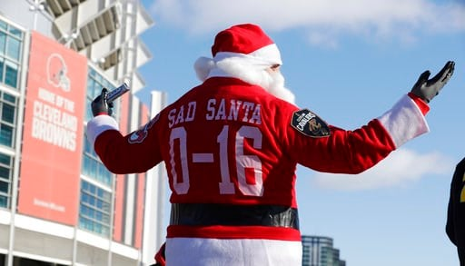 "(AP Photo/Tony Dejak). A Cleveland Browns fan dressed as Santa Claus participates in the ""Perfect Season"" parade, Saturday, Jan. 6, 2018, in Cleveland. The Browns became the second team in NFL history to lose 16 games in a season. In joining the 2008 D..."