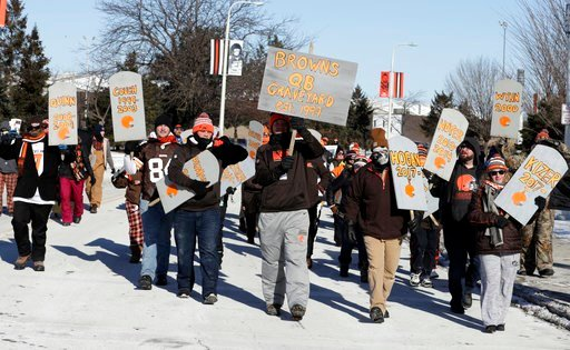 "(AP Photo/Tony Dejak). Cleveland Browns fans hold up gravestones with names of Browns quarterbacks during the ""Perfect Season"" parade, Saturday, Jan. 6, 2018, in Cleveland. The Browns became the second team in NFL history to lose 16 games in a season. ..."