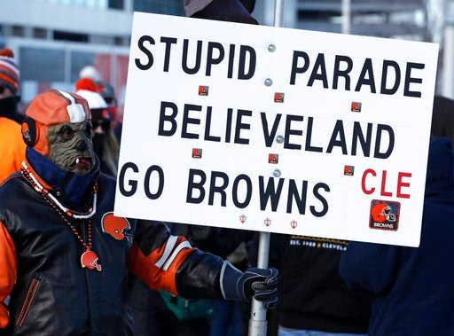 "(AP Photo/Tony Dejak). A Cleveland Browns fan watches the ""Perfect Season"" parade, Saturday, Jan. 6, 2018, in Cleveland. The Browns became the second team in NFL history to lose 16 games in a season. In joining the 2008 Detroit Lions in a shameful lose..."