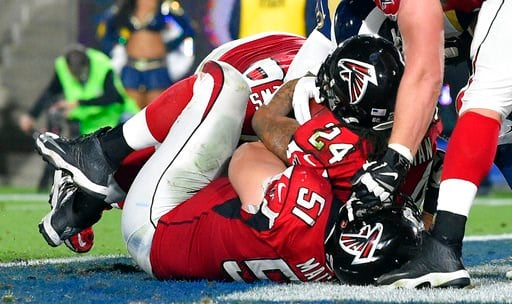 (AP Photo/Mark J. Terrill). Atlanta Falcons running back Devonta Freeman (24) scores against the Los Angeles Rams during the first half of an NFL football wild-card playoff game Saturday, Jan. 6, 2018, in Los Angeles.